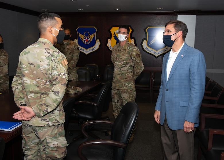 Then-Second Lt. Nephtali Castillo, 509th Operational Medical Readiness Squadron bioenvironmental engineer, meets then-Secretary of Defense Dr. Mark T. Esper, during a base visit by the senior defense official to Whiteman Air Force Base, Missouri, July 22, 2020. Castillo briefed Esper on his idea of bringing commissioned officer recruiting to his home island of Puerto Rico. (U.S. Air Force photo by 509th Bomb Wing Public Affairs)