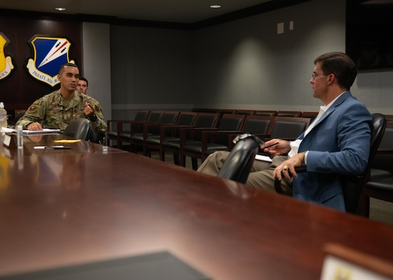 Then-2nd Lt. Nephtali Castillo, 509th Operational Medical Readiness Squadron bioenvironmental engineer, briefs then-Secretary of Defense Dr. Mark T. Esper, during a base visit by the senior defense official to Whiteman Air Force Base, Mo., July 22, 2020. Castillo briefed Esper on his idea of bringing commissioned officer recruiting to his home island of Puerto Rico.