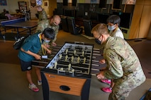 Misawa City English Camp students and 35th Force Support Squadron Airmen play foosball during a base tour at Misawa Air Base, Japan, Aug. 3, 2021. As the students visited the base, they were able to see various work centers, including the 35th Fighter Wing headquarters, 35th Force Support Squadron Misawa Teen Center, 35th Civil Engineer Squadron fire station, Naval Air Facility terminal, Commissary and Base Exchange. (U.S. Air Force photo by Airman 1st Class Antwain Hanks)