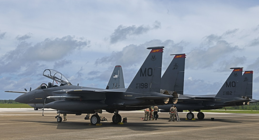 Three U.S. Air Force F-15E Strike Eagles from Mountain Home Air Force Base, Idaho, park at the Tinian International Airport, Tinian, July 27, 2021. Members from the 366th Fighter Wing arrived on Tinian for a historic first-time in order to support Pacific Iron 2021. Approximately 800 Airmen and 35 aircraft are participating in Pacific Air Forces' dynamic force employment operation July 11 to Aug. 8, 2021, in Guam and Tinian to project forces into U.S. Indo-Pacific Command's area of responsibility in support of the 2018 National Defense Strategy, calling on the military to be a more lethal, adaptive and resilient force. (U.S. Air Force photo by Tech. Sgt. Benjamin Sutton)