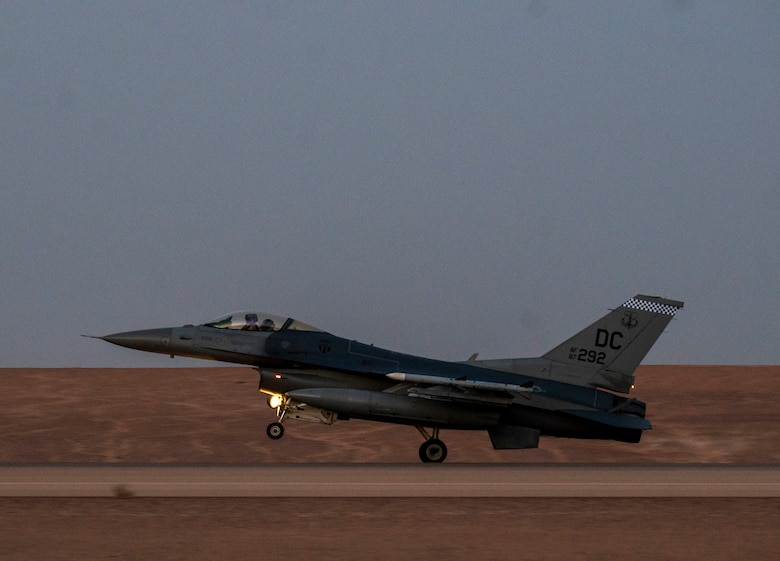 A U.S. Air Force F-16 Fighting Falcon lands on the runway at Prince Sultan Air Base, Kingdom of Saudi Arabia, after participating in a combined counter-unmanned aerial systems training operation with Royal Saudi aircraft, July 29, 2021. The event tested the ability of U.S. and Royal Saudi forces to collaboratively track and destroy a simulated invading UAS within regional airspace, continuing to demonstrate the shared focus on the security of regional airspace. (U.S. Air Force photo by Senior Airman Samuel Earick)