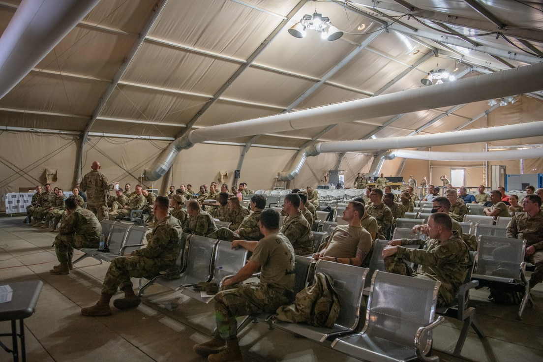 U.S. Air Force Col. Kevin Davidson, 378th Air Expeditionary Wing vice commander, addresses attendees of a Right Start briefing in the U.S. Passenger Terminal at Prince Sultan Air Base, Kingdom of Saudi Arabia, July 12, 2021.