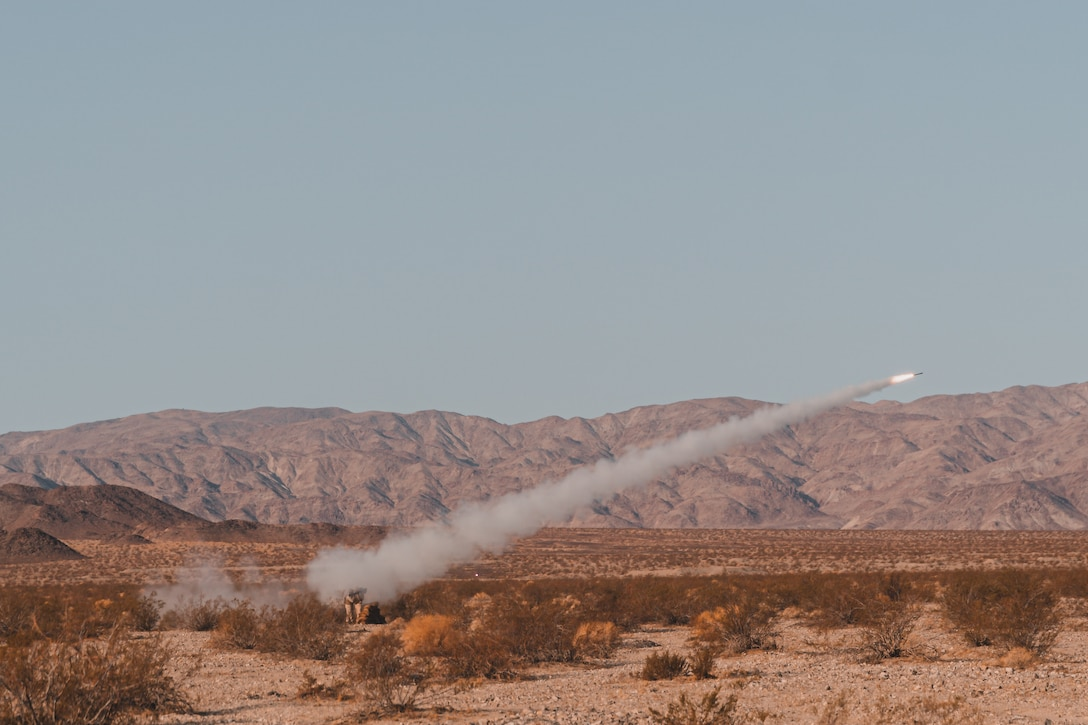A U.S. Marine Corps Low Altitude Air Defense (LAAD) Basic Officer Course student, assigned to the LAAD Training Section, Air Control Training Squadron, Marine Corps Communications-Electronics School fires an FIM-92 Stinger missile aboard Marine Corps Air Ground Combat Center, Twentynine Palms, California, July 16, 2021. The purpose of the exercise was to certify entry level LAAD students to fire the FIM-92 Stinger missile, a graduation prerequisite before moving to the Fleet Marine Force. (U.S. Marine Corps photo by Lance Cpl. Colton Brownlee)