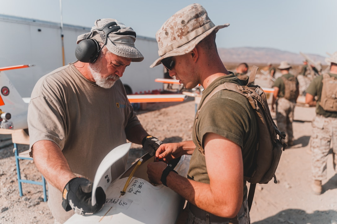A U.S. Marine Corps Low Altitude Air Defense (LAAD) Basic Gunner Course student assigned to the LAAD Training Section, Air Control Training Squadron, Marine Corps Communications-Electronics School assemble OUTLAW aerial targets aboard Marine Corps Air Ground Combat Center, Twentynine Palms, California, July 16, 2021. The purpose of the exercise was to certify entry level LAAD students to fire the FIM-92 Stinger missile, a graduation prerequisite before moving to the Fleet Marine Force. (U.S. Marine Corps photo by Lance Cpl. Colton Brownlee)