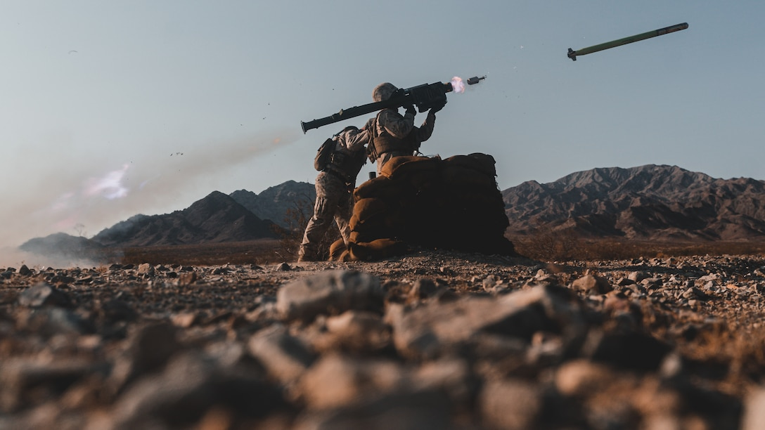 A U.S. Marine Corps Low Altitude Air Defense (LAAD) Basic Gunner Course student assigned to the LAAD Training Section, Air Control Training Squadron, Marine Corps Communications-Electronics School fires an FIM-92 Stinger missile aboard Marine Corps Air Ground Combat Center, Twentynine Palms, California, July 16, 2021. The purpose of the exercise was to certify entry level LAAD students to fire the FIM-92 Stinger missile, a graduation prerequisite before moving to the Fleet Marine Force. (U.S. Marine Corps photo by Lance Cpl. Colton Brownlee)