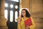 School girl holds notebook