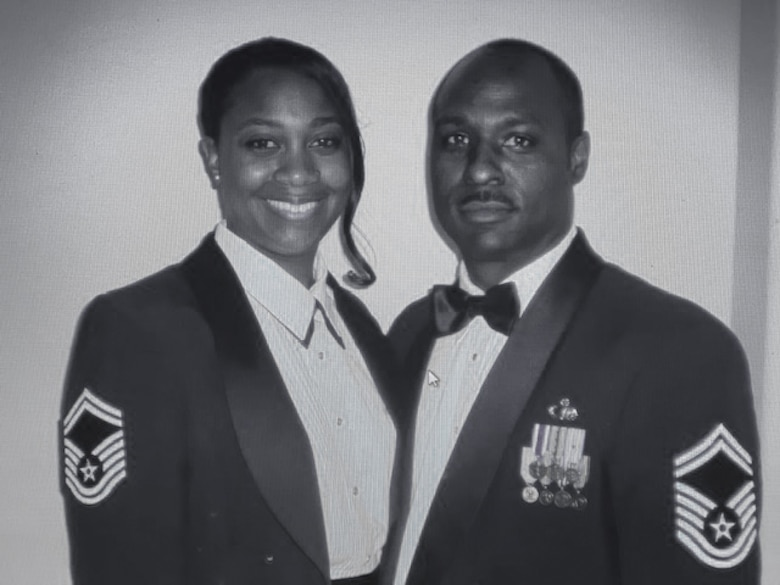 """Then-Senior Master Sgt. Kendall Briscoe stands alongside his wife, retired Senior Master Sgt. Jodie Briscoe, for a photo. Kendall described his wife as his """"North Star,"""" and credits her with being a big motivator throughout his career. A self-proclaimed """"power couple,"""" Kendall and Jodie retired as chief master sergeants. (Courtesy photo)"""