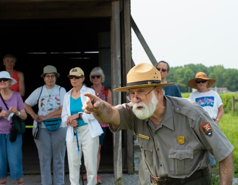 Robert Peterson of the National Park Service talks about the history of Huffman Prairie at Wright-Patterson Air Force Base on July 19 as visitors take part in a nature walk sponsored by the 88th Civil Engineer Group's Environmental Branch. Huffman Prairie.