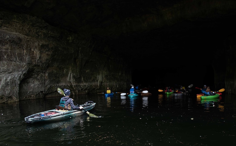 Kayakers at the mouth of a cave