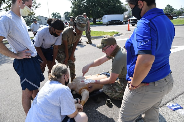U.S. Air Force Staff Sgt. Timothy Parde, 81st Medical Support Squadron emergency medical services site coordinator, provides a triage procedure demonstration during a Tactical Combat Casualty Care Rodeo at Keesler Air Force Base, Mississippi, August 5, 2021. The rodeo, a Ready Eagle Training component, provides practical hands-on critical medical trauma skills training for 81st Medical Group personnel. (U.S. Air Force photo by Kemberly Groue)