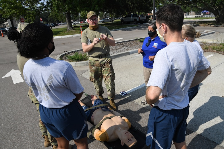 U.S. Air Force Staff Sgt. Timothy Parde, 81st Medical Support Squadron emergency medical services site coordinator, reviews triage procedures during a Tactical Combat Casualty Care Rodeo at Keesler Air Force Base, Mississippi, August 5, 2021. The rodeo, a Ready Eagle Training component, provides practical hands-on critical medical trauma skills training for 81st Medical Group personnel. (U.S. Air Force photo by Kemberly Groue)