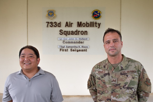 U.S. Air Force GS-11 employee Brandon Yoneda, air terminal operations duty officer, and U.S. Air Force Staff Sgt. Kyle Kemble, asset evaluator, both with the 733rd Air Mobility Squadron, pose for a photo at Kadena Air Base, Japan, Aug. 5, 2021.