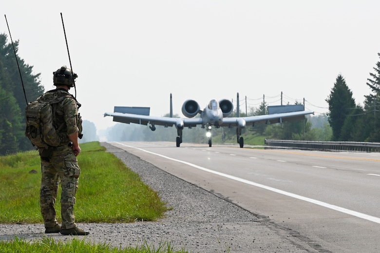 A U.S. Air Force 127th Wing A-10 Thunderbolt II, with ground air traffic control and guidance provided by Special Tactics operators from the 24th Special Operations Wing, lands on a closed public highway Aug. 5, 2021 at Alpena, Mich., for the first time ever as part of a training exercise during Northern Strike 21. The joint training event tested part of the agile employment concept, focusing on projecting combat power from austere locations. (U.S. Air Force photo by Staff Sgt. Ridge Shan)