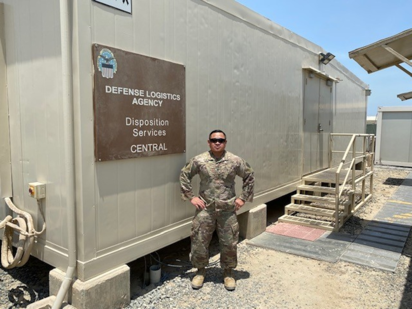 Man stands by DLA sign