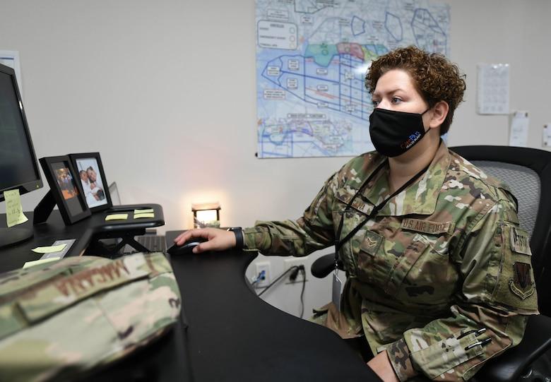 U.S. Air Force Airman 1st Class Hailey Magana uses a computer at Tyndall Air Force Base, Florida, August 5, 2021.
