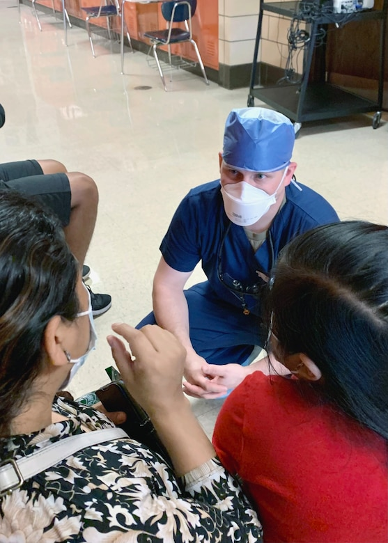 U.S. Air Force Captain Neal Esplin, a dentist from the 162nd Medical Group, Morris ANGB, Tucson, Arizona, speaks with a patient at the Operation Healthy Delta clinic site in Metropolis, Illinois, June 15. The operation is a U.S. Department of Defense Innovative Readiness Training mission, offering readiness training to multi-service, interagency, and community partners, while providing no-cost healthcare to the community. (U.S. Air National Guard Photo by Major Mary Hook/Released)