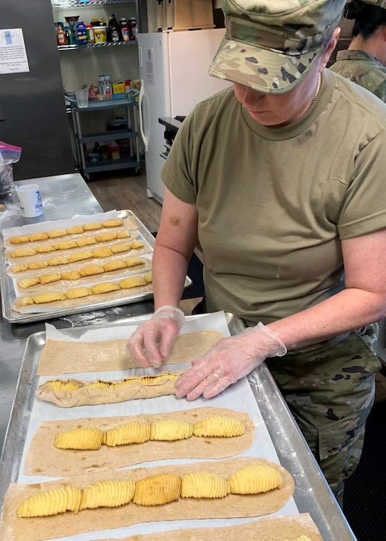 Staff Sgt. Trisha Willis, a food services technician from the 162nd Wing, Morris Air National Guard Base, Tucson, Arizona, prepares apple tarts for a visit from distinguished visitors at the Operation Healthy Delta site in Sikeston, Missouri, June 16. The operation is a U.S. Department of Defense Innovative Readiness Training mission, offering readiness training to multi-service, interagency, and community partners, while providing no-cost healthcare to the community. (U.S. Air National Guard Photo by Major Mary Hook/Released)