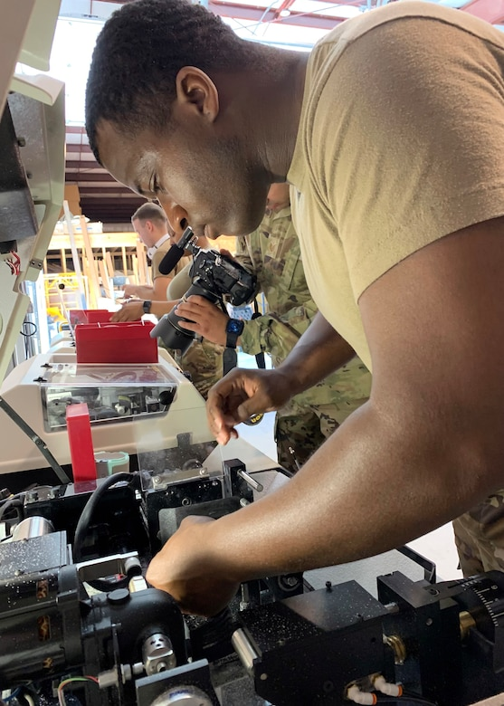 U.S. Army Sgt. John Stewart, assigned to the166thMedical Detachment, 56thMultifunctional Medical Battalion, Fort Lewis-McCord, Washington, operates an optical lens fabrication machine at the Operation Healthy Delta site in Sikeston, Missouri, June 16. The operation is a U.S. Department of Defense Innovative Readiness Training mission, offering readiness training to multi-service, interagency, and community partners, while providing no-cost healthcare to the community. (U.S. Air National Guard Photo by Major Mary Hook/Released)