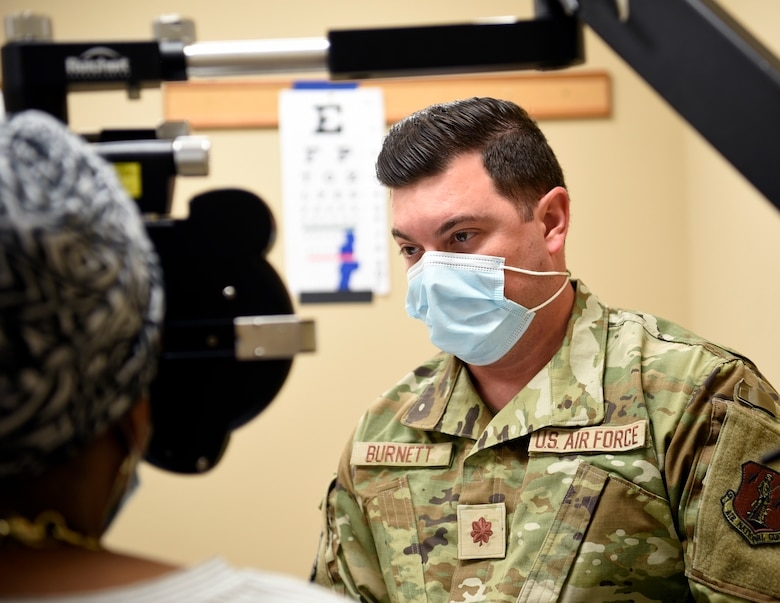 U.S. Air Force Capt. Erik Burnett, an optometrist assigned to the 162nd Medical Group, Morris ANGB, Tucson, Arizona, performs an eye exam on a patient at the Operation Healthy Delta clinic site in Sikeston, Missouri, June 21. The operation is a U.S. Department of Defense Innovative Readiness Training mission, offering readiness training to multi-service, interagency, and community partners, while providing no-cost healthcare to the community. (U.S. Air National Guard Photo by Technical Sgt. Rafael Medina/Released)