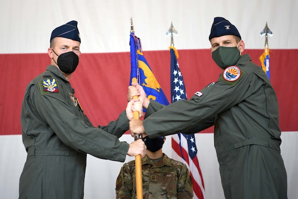 LUKE AIR FORCE BASE, ARIZ. – Reserve Citizen Airman Col. Mark Van Brunt, 944th Fighter Wing commander, presents Col. Brett Comer command of the 944th Operations Group during a change of command ceremony, August 6, 2021 at Luke Air Force Base, Arizona. Comer was the previous commander of the 301st Operations Support Squadron, 301st Fighter Wing, at Nellis Air Force Base, Neveda. (U.S. Air Force Photo/Tech. Sgt. Courtney Richardson)