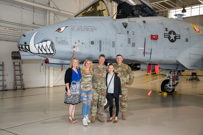 U.S. Air Force Lt. Col. William McLeod poses with his family after his assumption of command ceremony on Aug. 7, 2021 at Whiteman Air Force Base, Mo. (U.S. Air Force photo by Maj. Shelley Ecklebe)
