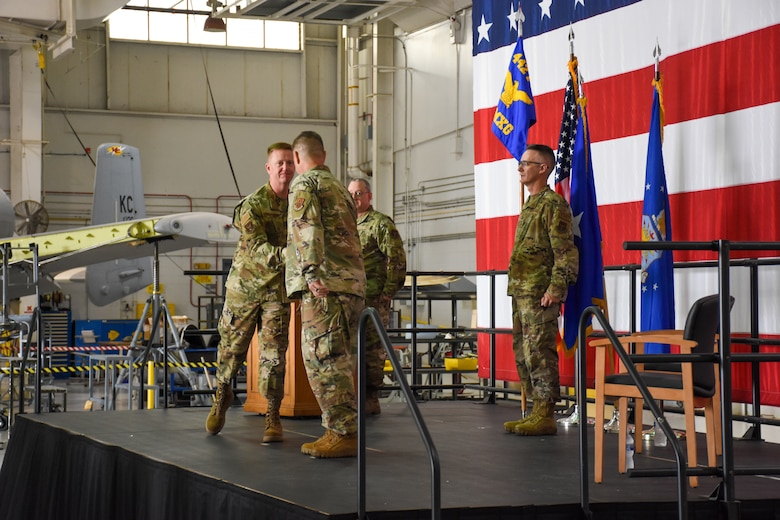 U.S. Air Force Brig. Gen. Michael Schultz, 442d Fighter Wing Commander, left, congratulates Lt. Col. William McLeod, in-coming 442d Maintenance Group Commander, during his assumption of command ceremony on Aug. 7, 2021 at Whiteman Air Force Base, Mo. (U.S. Air Force photo by Master Sgt. Robert Jennings)