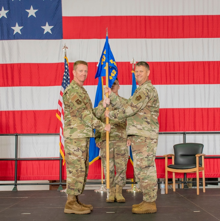 U.S. Air Force Brig. Gen. Michael Schultz, 442d Fighter Wing Commander, left, passes the unit flag to Lt. Col. William McLeod, in-coming 442d Maintenance Group Commander, for the 442d Maintenance Group assumption of command ceremony on Aug. 7, 2021 at Whiteman Air Force Base, Mo. (U.S. Air Force photo by Maj. Shelley Ecklebe)