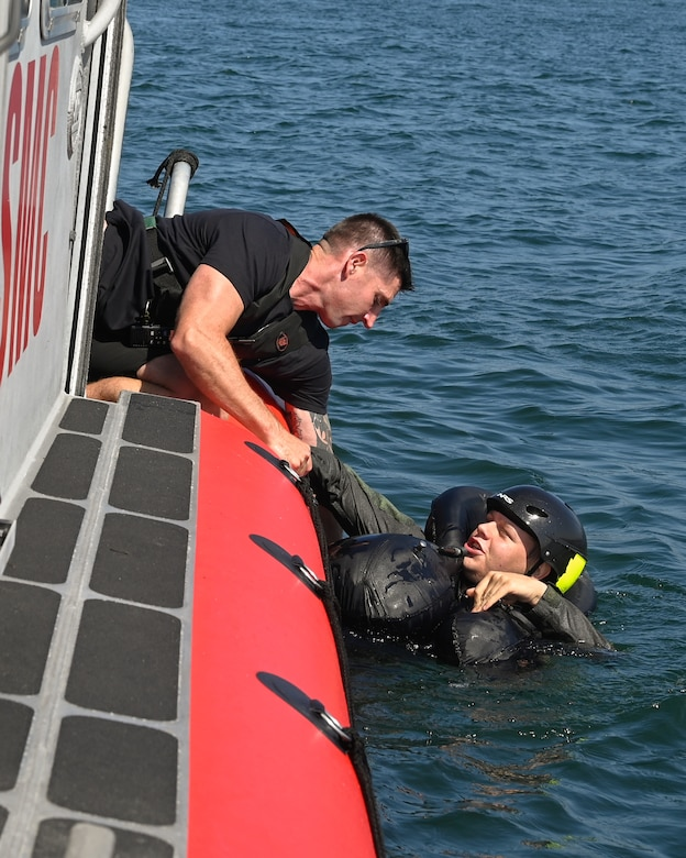 U.S. Marine Corps Gunnery Sgt.  Micahel O'Brien, high risk training instructor, pulls U.S. Air Force 2nd Lt. Thomas Schneider, 162nd Wing F-16 pilot, out of the water after the helicopter extraction exercise at Naval Amphibious Air Base Coronado in San Diego, July 9. Pilots must complete water survival training every three years to maintain combat readiness.  (U.S. Air National Guard photo by Staff Sgt. Aubrey Pomares)