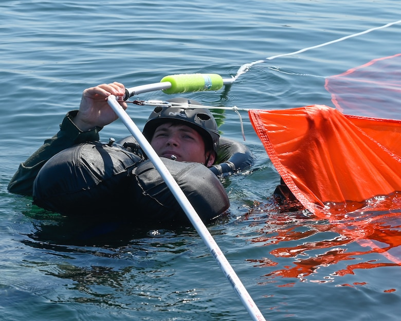 U.S. Air Force 1st Lt. Zachary Bailey, 144th Fighter Wing pilot, navigates the parachute entanglement portion of water survival training at Naval Amphibious Air Base Coronado in San Diego, July 10. Pilots must complete water survival training every three years to maintain combat readiness. (U.S. Air National Guard photo by Staff Sgt. Aubrey Pomares)