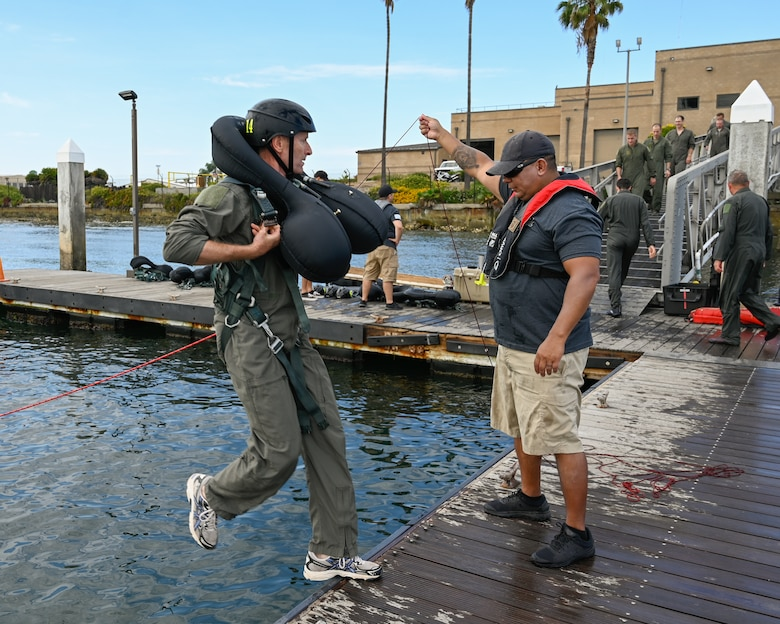 U.S. Air Force Brig. Gen. Jeffrey L. Butler, 162d Wing Commander, steps off the dock for the parachute drag portion of water survival training at Naval Amphibious Air Base Coronado in San Diego, July 10. Pilots must complete water survival training every three years to maintain combat readiness.  U.S. Air National Guard photo by Staff Sgt. Aubrey Pomares)