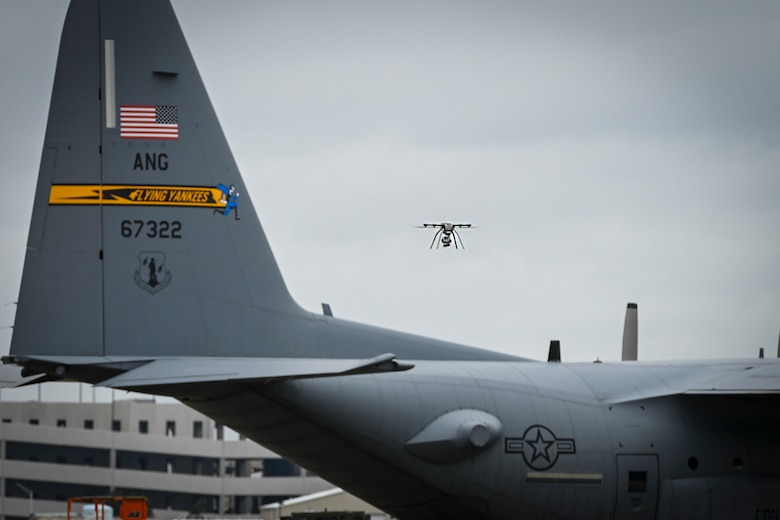 A small unmanned aircraft system flies over Bradley Air National Guard Base during a drone response exercise conducted at the installation in East Granby, Connecticut, Aug. 5, 2021.  With the increased prevalence of drone activity around the world, the 103rd Security Forces Squadron partnered with the Transportation Security Administration and Connecticut State Police to conduct a multi-agency antiterrorism exercise that tested the base's response to a drone incursion. (U.S. Air National Guard photo by Tech. Sgt. Steven Tucker)