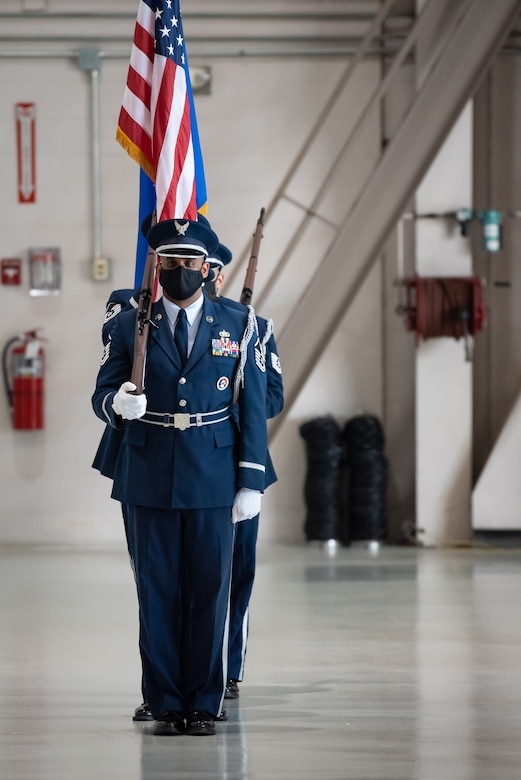 The 123rd Airlift Wing Honor Guard presents the colors during a ceremony to install a new commander of the 123rd Airlift Wing at the Kentucky Air National Guard Base in Louisville, Ky., Aug. 7, 2021. Col. Bruce Bancroft assumed the role from Col. David Mounkes, who had served as wing commander since 2016. (U.S. Air National Guard photo by Dale Greer)