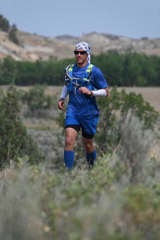 Senior Master Sgt. Brandon Miller runs through the rugged terrain of the North Dakota badlands Maah Daah Hey Trail during the 107.3-mile ultramarathon held July 31 through Aug. 1, 2021.