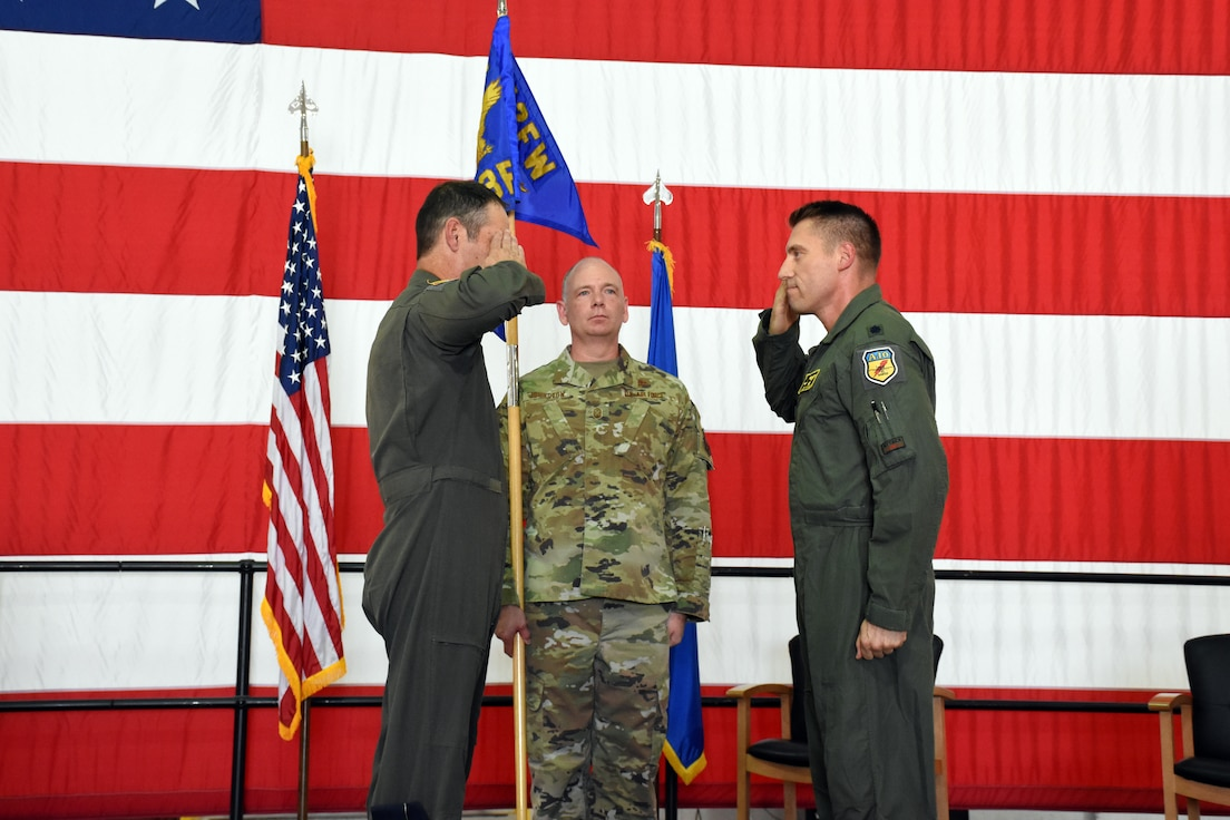 U.S. Air Force Lt. Col. Ryan Hodges renders his first salute to Col. Michael Leonas, the 442d Operations Group Commander, after assuming command of the 303rd Fighter Squadron on Aug. 7, 2021, at Whiteman Air Force Base, Mo. (U.S. Air Force photo by Senior Airman Alex Chase)