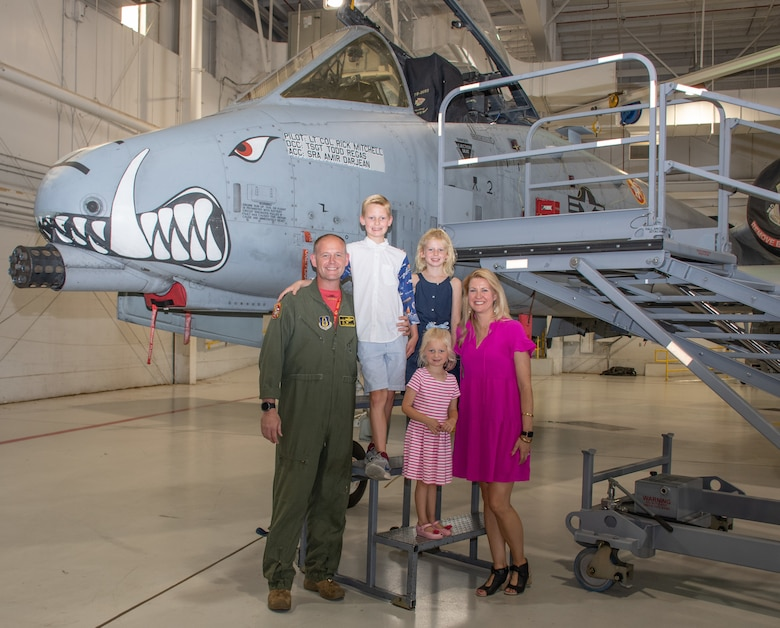 U.S. Air Force Lt. Col. Rick Mitchell and his family get one last picture in front of his A-10C Thunderbolt II prior to the 303rd Fighter Squadron change of command ceremony on Aug. 7, 2021, at Whiteman Air Force Base, Mo. (U.S. Air Force photo by Maj. Shelley Ecklebe)