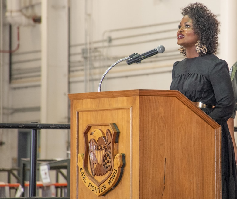 DoD Civilian, Mrs. Octaver Robinson sings the National Anthem during the 303rd Fighter Squadron change of command ceremony on Aug. 7, 2021, at Whiteman Air Force Base, Mo. (U.S. Air Force photo by Maj. Shelley Ecklebe)