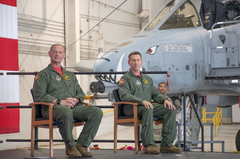 U.S. Air Force Lt. Col. Rick Mitchell, left, and Lt. Col. Ryan Hodges listen to Col. Michael Leonas, the 442d Operations Group Commander and the officiant for the 303rd Fighter Squadron change of command ceremony on Aug. 7, 2021, at Whiteman Air Force Base, Mo. (U.S. Air Force photo by Maj. Shelley Ecklebe)