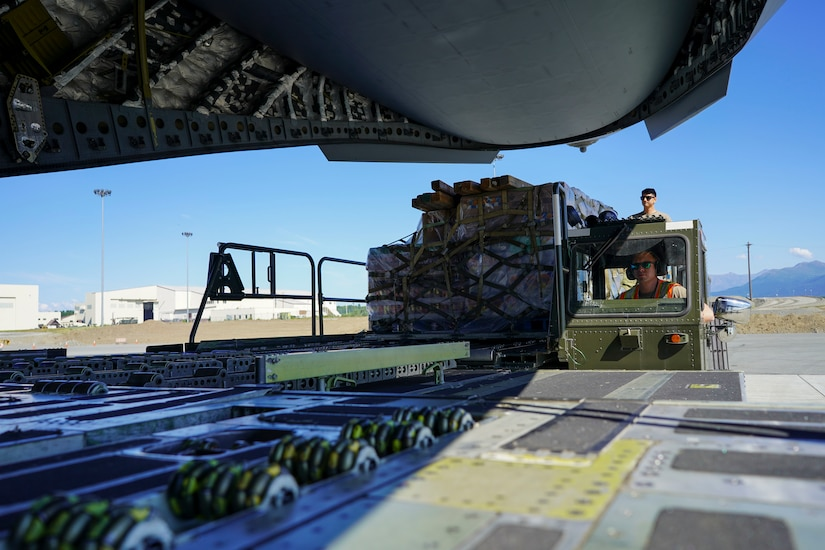 JOINT BASE ELMENDORF-RICHARDSON, Alaska -- The Alaska National Guard transports cargo for the Defense Commissary Agency from Joint Base Elmendorf-Richardson via a C-17 Globemaster III aircraft from the 176th Wing's 144th Airlift Squadron to the remote village hub of Bethel, Alaska, Aug. 2, 2021. The AKNG partnered with DeCA in order to provide discounted groceries to eligible military- and DoD-affiliated patrons during a one-day event Aug. 7. (U.S. Army National Guard photos by 1st Lt. Balinda O'Neal Dresel)