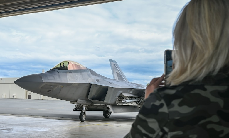 Lt. Col. Ryan Pelkola arrives from his flight while his wife takes a photo.