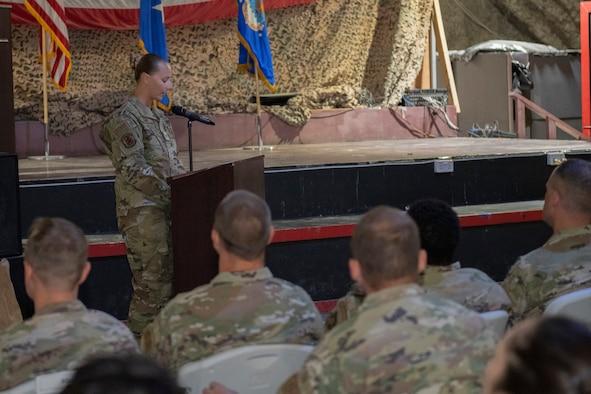 U.S. Servicemembers sit in an audience