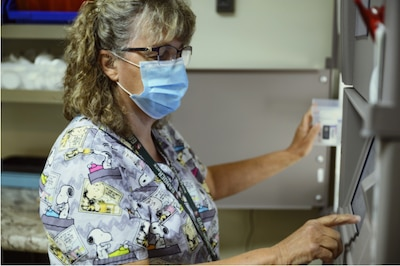 Sherry Morgan, 341st Operational Medical Readiness Squadron pharmacy technician, prepares a patient's prescription July 14, 2021, at Malmstrom Air Force Base, Mont. In addition to active duty and dependent care, the pharmacy also serves retirees. (U.S. Air Force photo by Senior Airman Jacob M. Thompson)