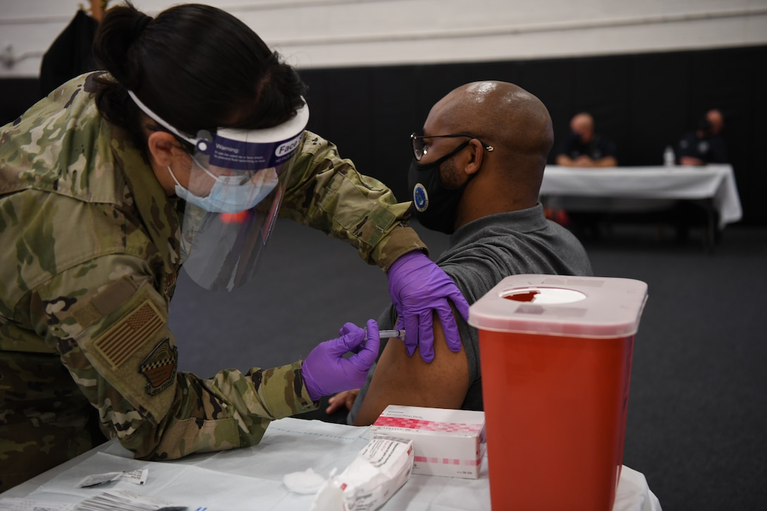 A member of team Homestead receives the COVID-19 vaccine at a vaccination event during the August Unit Training Assembly Aug. 7, 2021 at Homestead Air Reserve Base, Florida. (U.S. Air Force photo by Tech. Sgt. Allissa Landgraff)