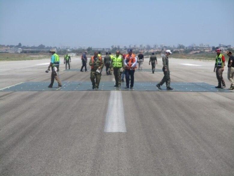 Engineers check a runway repair