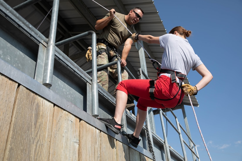 A freedom Academy delegate rappels from a tower