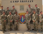 Soldiers assigned to 1st Battalion, 3rd Security Force Assistance Brigade stand for a group photo at Camp Arifjan, Kuwait.  The 3rd SFAB conducts worldwide security force assistance operations at the operational and tactical level to help develop the capacity and capability of foreign security forces. (Courtesy photo)