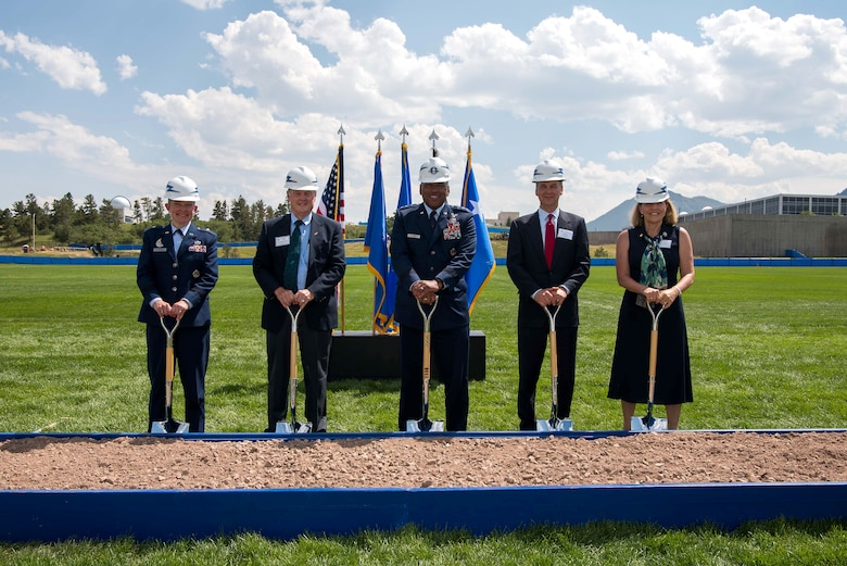 Lt. Gen. Richard Clark, U.S. Air Force Academy superintendent (center), joins senior officials for a photo during a ceremony to recognize the Madera Cyber Innovation Center's ground-breaking on Stillman Parade Field
