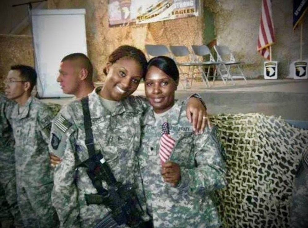 daughter hugs mother while deployed in Afghanistan