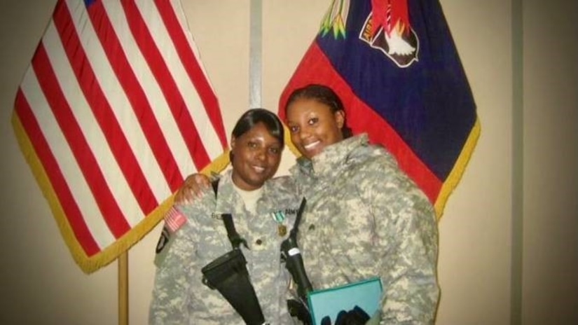 female soldier hugs female soldier and mother