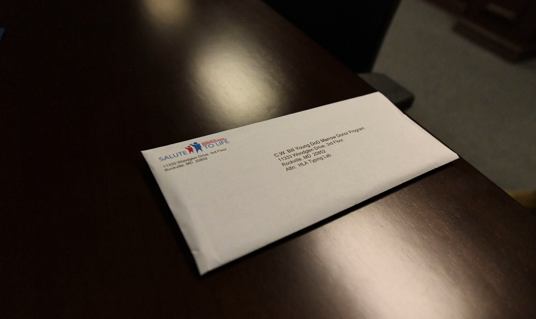 A single envelope lays on a table.