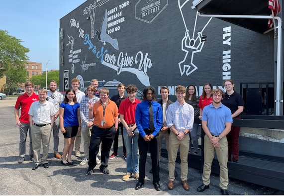 """A cohort of interns smiles for a group photo in front of the Wright Brother Institute's downtown location, Aug. 10, 2021, in Dayton, Ohio. These students are participants in the """"Summer of Innovation - Digital Drone"""" program. (Courtesy photo)"""